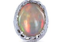 """Opals / A truly an amazing gemstone. The origin of the word """"opal"""" is actually Greek meaning """"to see a change"""", of course, referring to color. Opals come in a variety of colors, ranging from the most """"common"""" milky white to black, with flashes of every color such as red, orange, yellow, green, blue shining through. Impurities in the stone also play a factor in the color of the opal. / by Shreve, Crump & Low"""