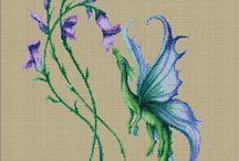 Cross stitch patterns on hand / by Patti Carey