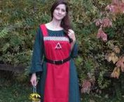 Viking Apron Dresses / This is a popular alternative style of the viking apron dress, functional and authentic for any religious or recreational events.   Made from 100% linen fabric, this lovely apron is purposely designed to be worn over a kirtle or undergown, draped over the shoulders and secured with a belt around the waist. An eye-catching knot work jacquard trim adorns the top and bottom hems on the front and back panels. View our full selection or order a custom apron dress at FriggasFinery.com