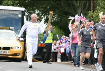 #PictureThisTPE Torchbearers / For this #PictureThisTPE competition, we want to you send us your pictures of the torch making its way across our routes or, if you're not lucky enough to catch a glimpse of it, your own creative tribute to the torch. The best #PictureThisTPE entry will win 2 first class tickets on our routes. The competition ends on Friday 29th at 12pm. See terms and conditions: http://bit.ly/JPowIm