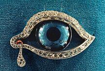 evil eyes / by Yolanda De La Vega