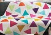 Modern Quilts / These quilts are good examples of the Modern Quilt aesthetic. Clean lines, functional intent, bold colors, high contrast and graphic punch, improvisational piecing, negative space, and alternate grid work appear in many of these modern quilt patterns. Get inspired for your next Modern Quilt project right here!