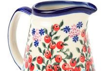 pitchers n' pottery / pottery, pitchers and any type of crockery.  My grandmother had all beautiful bowls and pitchers on shelves along her ceiling in Germany. I've loved pottery pitchers every since.