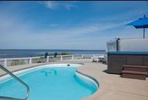 Outer Banks Soundfront Vacation Rentals from Village Realty / Sunsets, quiet, views, and nice rates. Book a home on the soundfront and see what the locals know. Pools, hot tubs, game rooms. Dog friendly available. Phone: 855.585.8811. www.VillageRealtyOBX.com;