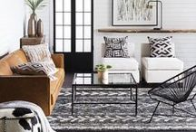 """Fall 2017 Trend: Instinct / Global is made modern and relevant with Surya's Fall 2017 """"Instinct"""" trend, showcasing a stylish, black and white urban interior. Fur and hides bring softness to its clean balanced lines, while textiles remain authentic and accessories purposeful."""