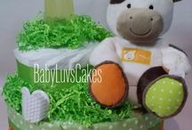Diaper Cakes designed by BabyLuvsCakes / Diaper cakes by Diana Lee designer of BabyLuvsCakes. Grandmother  infusing a little Philly style into these adorable baby gifts