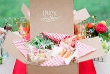 Picnic Wedding / For the laid-back or outdoor-loving couple, a picnic themed wedding may be just the thing.  Your picnic wedding could be as fancy or relaxed as you want.  Keep your guests satisfied with signature red cocktails and strawberry shortcake in red-and-white checkered paper cartons.  When it comes time to eat, each guest can choose an adorable boxed meal with a menu printed on a sticker on the front of the box.