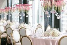 Hanging Wedding Decorations / Nothing screams romance and elegance more than hanging wedding decorations.  You can hang decor over your reception tables, over a dance floor, or in tree branches.  Just keep in mind, hanging decorations can get expensive. To do it right, you need to go big and don't skimp.  Otherwise, it will look unfinished.  While it may be pricey to do hanging wedding decorations over each reception table, consider using them only above the head table which would be a more affordable splurge!
