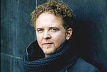 Music: Mick / Michael James Hucknall, commonly known as Mick 'Red' Hucknall, is the lead singer of the British soul-pop band 'Simply Red'. Born 8-6-1960 in Manchester, UK.