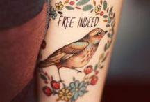 tattoos / by Savannah Graham