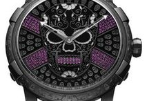 """COLLABORATIONS I Historical Icons / The watchmaking Maison integrates a contemporary philosophy into its timepieces through generational references such as video games, music, tattoos, cars, street art and contemporary art. Through unique collaborations, RJ-Romain Jerome transforms watches into inspired """"talking pieces"""" capable of creating a distinct sense of affinity with those who wear them."""