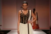 InFeature Designer: Joy Mitra / This Spring-Summer, designer Joy Mitra explores the colonial era of costuming when British seamstresses joined hands with Indian masterjis to create a fusion silhouette. Highlights of the collection are the mix of nets and georgette. Interesting embroideries and textural treatments among others create these Indian silhouettes, reminiscent of the Raj. / by Exclusively In
