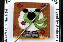 Needlepoint Accessories & Tools / stuff for your needlepoint including scissors, stands, laying tools, stretcher bars, needle minders, and many other needlepoint tools.