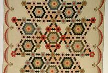 Hexies - Hexagonal Quilts & More / These quits & other crafts are all based on hexagons. Most can be easily adapted to needlepoint using trianglepoint, a hex made of Mosaic stitches, or the beetle stitch.