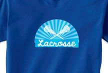 Lacrosse T-Shirts / Our guy's Lacrosse Tees are made to be cool and comfortable. With over 150 designs on a wide selection of apparel choices - short sleeve, long sleeve, and performance tees - and multiple color options, you can choose a lax tee that best represents your love for the sport. Personalize your lacrosse shirt with your name and number. Youth and adult sizes available on most designs.  Only from ChalkTalkSPORTS.com!