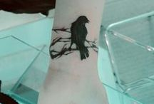 """tattoo / I'm getting a tattoo.  I want a bird on a branch or tree.  Wings to symbolize freedom, (roots of the) tree to symbolize where you're from. """"The bird is not afraid of the branch breaking, because her trust is not in the branch, but in her wings""""."""