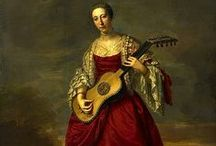 music art / paintings and sculptures with guitars, lutes and other instruments