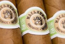 Macanudo Cigars / Macanudo was originally the name of a cigar brand frontmark produced in Jamaica by the makers of the Cuban brand of Punch cigars.  In 1971, General Cigar Company introduced a new cigar named Macanudo Cigars as a brand unto itself. Developed in Jamaica under the creative leadership of Ramon Cifuentes, the legendary Cuban cigar master of Partagas, Macanudo cigars soon became the leading premium cigar and remains so today. / by Absolute Cigars