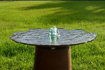 """Birdfeeders, Birdbaths & Fountains / Trafficlight Birdfeeder Birdbath is upcycled from a 12"""" trafficlight and a 100 year old insulator. it comes with a 10"""" bicycle spoke hook and a seed starter sack. purchase one for $49.95 contact me at: tim@railroadware.com"""