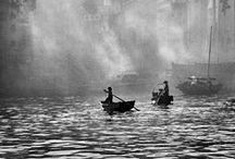 Fan Ho / Fan Ho is Hong Kong's Bresson. Asked to name his three favourite photographers he replied: Henri. Cartier. Bresson. Fan Ho calls the streets Living Theatre, his photos display a fascination with urban life, explored alleys, slums, markets and streets. His photos are abstract and humanistic at the same time. Now based in California Fan Ho arrived in Hong Kong in the 1940s from Shanghai and is its definitive street chronicler.