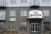 Fosshotel Baron - Hotel in Reykjavik /  Downtown convenience and comfort Fosshotel Baron stands right in the heart of Reykjavík, near the seafront, within walking distance of shops and attractions. The hotel offers both hotel rooms and apartments, perfect for families or small groups travelling together. Enjoy a scenic walk by the seaside, visit Harpa Concert Hall and try some of Reykjavík's great restaurants and cafés, all just a stone's throw away.