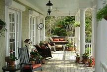Sittin' on the Front Porch / I *ԼƠƔЄ* the look of a comfortable front porch with a painted floor, wicker furniture and cozy fabrics. Most of these are obviously not living spaces for the climate in Nebraska: Wind, rain, dust, mosquitoes--but I can dream.