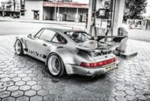 RAUH-Welt BEGRIFF / RWB/RAUH-Welt BEGRIFF is a Porsche tuner located in Japan. RWB has combined Japanese and Euro tuning elements, creating the distinct RWB style for Porsche chassis. Starting off as a small countryside body-shop in Chiba-Ken, RAUH-Welt 911's are now a common sight on both the streets and racing circuits of Japan.  They create only one RWB Porsche for each customer.