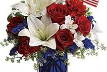 Patriotic Tribute / Red, white and blue flowers adorned with stars and stripes and the US flag. Perfect for Veterans Day and Memorial Day tributes as well as decorating 4th of July picnics and BBQs.