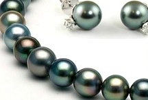 Tahitian Pearls / Tahitian pearls are glamorous, exotic and luxurious.  The dark colors with a large variety of overtone colors and often intense rainbow-like orient give them a glamour value unlike other pearls.