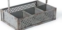 Industrial Chic / Hand-crafted from galvanized metals, each sculpture, votive and shelving unit is built to last while maintaining its timeless good looks. We also offer several styles of galvanized metal bins that handle whatever life throws into them, keeping you seamlessly organized.