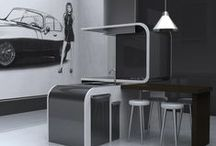 Isola / Island is developed starting from the use of panels in anodized titanium that curved and laminated with materials such as wood and steel are drawing a modular kitchen island