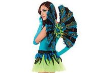 Pretty as a Peacock / Show off more than your feathers this Halloween with beautifully bold peacock mix and match options! Adorn yourself with punchy shades of emerald and teal with stunning feathered hats, arm bands and iridescent skirts. Really ruffle some feathers as you transform into the most sought out animal in the room in sexy feathered bras, wings and alluring masks. Just like the majestic animal, everyone will be awe-inspired by you!