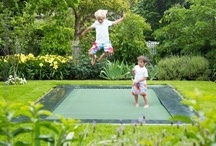 client board: young  family with kids / clients needs: to landscape a steep backyard for kids; with a big swath of lawn; an area for an in-ground trampoline; a staircase to connect two decks; privacy from the neighbors ...