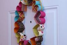 Decor For The Door / I LOVE adding a seasonal wreath to our front door or anything beautiful, for that matter. I even adorn our exterior wall, adjacent to our front door with something beautiful [not gaudy] and simple. / by Cat Aldridge