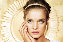 Guerlain Terra Ora Summer Makeup Collection 2013 / The Terra Ora Summer collection draws its essence from an era of magnificence. An ode to gold. With dazzling radiance, Terra Ora bronzing powder and the precious Météorites Perles primer adorn the skin in a warm, divine-like light.  The eyes are highlighted with a generous sweep of Khôl Me Kajal and the lids illuminated with a golden copper or patinated bronze glow. Pure, fresh and glowing complexion. Like a second skin, Lingerie de Peau BB protects, evens the skin texture and blurs