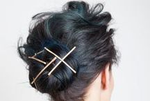 How-To: Soft Updo & DIY Accessories / We were inspired to give the winter updo a more modern and decorative approach. We started with the concept of a pulled back hair chignon and added flirty, feminine movement with windswept texture. Then, we took the most simple accessory - the bobby pin - and found a cool way to wear this staple so that it translates to fancy and fabulous!  Hair by NYC master stylist Kattia Solano using Oribe products