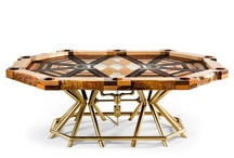 """All In"" Custom Poker Table / ""All In"" required over 600 man-hours of labor to create. The surface was constructed using fifteen species of exotic wood. The base was fabricated with gold-painted plumbing pipes and fittings, and Edison Reproduction Light Bulbs. 