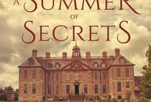 A Summer of Secrets / Sophia returns to Yorkshire to work as tour guide at Heaton Abbey and meets the reclusive Thomas, Baron Heaton, a lonely workaholic. Despite having a rule never to get involved with her boss, Sophia finds him incredibly attractive. When she overhears the secret surrounding his parentage, she is torn. But is it her attraction to him or the fear of opening a Pandora's box that makes her keep quiet? How long can Sophia stay at Heaton Abbey knowing what she does? http://mybook.to/ASummerOfSecrets
