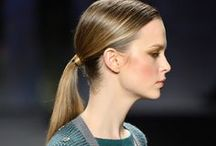 Vivienne Tam Fall 2014 / Sublime, heavily textured designs called for TRESemmé to create severe side parts and swept-back ponies.
