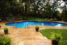 Woodland View / Swimming pools in a wooded area.