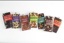 """TAVALOZZA Chocolate Bars / Cocoa Dolce's collection of Tavalozzas offer an abundance of flavor combinations, delivering an even wider range of taste experiences. Ingredients such as blueberries, apricots, candied ginger, pumpkin seeds and more bring these 3/8"""" -thick chocolate tablets to life with decadent flavor."""