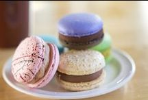 Macarons / A macaron is a sweet meringue-based cookie made with egg whites, icing sugar, granulated sugar, almond flour, and food colouring. The macaron is commonly filled with ganache, buttercream or jam filling sandwiched between two cookies. Our macarons are filled with ganaches.