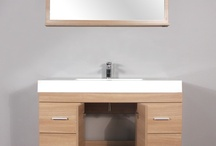 AT-8042-LO Modern Bathroom Vanity  / This unique modern design bathroom vanity will give your bathroom a trendy and totally up-to-date appearance. •Highest quality MDF/Wood veneer cabinet. •Light oak cabinet. •White acrylic sink. •Pop-up drain assembly. •Self closing door & drawers.  •Matching mirror. •Side cabinet available. •Vanity has opening for plumbing. •Single hole faucet openings. •Minimal assembly required (finished cabinet).