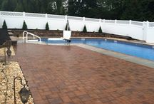 Poolside Hardscape Installation / Landscape of beautiful paver patio & large retaining wall around in-ground pool in East Berlin, York County, Pa...