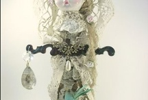 altered, assemblage and found object dolls / by Cory Marcsis