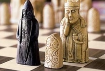 Lewis Chessmen / The Lewis Chessmen Probably made in Scandinavia, thought to be Norway, about AD 1150-1200   Found on the Isle of Lewis, Outer Hebrides, Scotland  The chess pieces consist of elaborately worked walrus ivory and whales' teeth in the forms of seated kings and queens, mitred bishops, knights on their mounts, standing warders and pawns in the shape of obelisks.