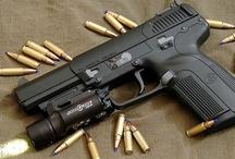 ...Hand Guns,Rifles, Ar's !! / by Tony Pellinghelli