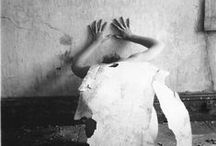 Photographer: Francesca Woodman / Francesca Woodman (April 3, 1958 - January 19, 1981) was an American photographer best known for her black and white pictures featuring herself and female models. Many of her photographs show young women who are nude, who are blurred (due to movement and long exposure times), who are merging with their surroundings, or whose faces are obscured.  She studied in Rome and spoke fluent Italian.Her work continues to be the subject of much attention, years after she committed suicide at the age of 22.