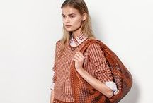 CHECK, PLEASE / It's a pattern play that's timeless. Earthy red and white checks smarten up a tweed skirt and the crisp collar of a button-down. A Veneta bag in Arizona red seals the deal. / by Bottega Veneta