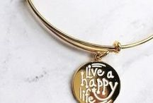 Be the Change // CHARITY BY DESIGN Collection / Charity is the heart and soul of ALEX AND ANI. CHARITY BY DESIGN (CBD) promotes love, empowerment and community. Each of our CBD products support a special cause with 20% of all sales donated directly to the charity partner.